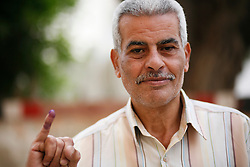 """I hope the outcome will be good. It's unclear what's next. I hope I can be optimistic. I voted for Hamdeen Sabahi, and he's the only one who represents the revolution."" - Nabil Shikry Anis, 56"