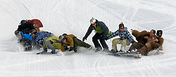 NEWS&GUIDE PHOTO/PRICE CHAMBERS.They all fall down together as Eric Sweet leads the first ever descent of a ten-man snowboard on Wednesday at Jackson Hole Mountain Resort. No April Fool's joke, the ten men are all Jewish and hope to qualify for the Guiness Book of World Records. Sweet used a handheld GPS to measure the distance of their longest run at 215 feet. The board is assembled on the slope with wing nuts after each rider brings his piece up the chairlift.