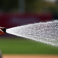 Mar 14, 2013; Sarasota, FL, USA; Grounds crew water the field before the game between the Tampa Bay Rays and the Baltimore Orioles at Ed Smith Stadium.