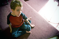 JEROME A. POLLOS/Press..Despite losing his ability to walk and see, Alex Hess manages to navigate his way through his home on the floor and often gives his family a pinch or nudge to get their attention.
