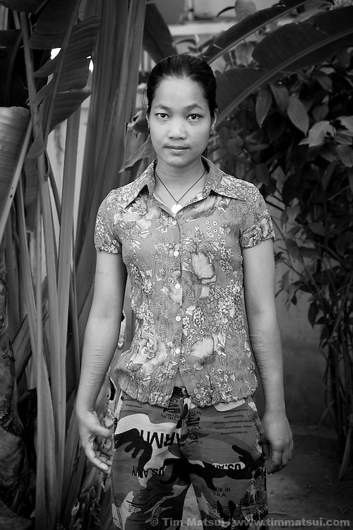 """Srey Kah, a prostitute after a clinic visit at the NGO """"Acting for Women in Distressing Situations"""" (AFESIP) which conducts outreach and provides services in Phnom Penh, Cambodia for victims of sex trafficking. Srey Kah was raped at 16 in her home town, later she was sold by a friend and held captive as a sex worker, then arrived in Phnom Penh and turned to prostitution to survive; she has survived beatings, gang rapes, drugs, and self mutilation. She continues as a prostitute so she can support her mother and put her younger sister through public school. Srey Kah's story is not unique. AFESIP offers housing, education, training, and counseling for women who are victims of sex trafficking, worked as prostitutes, or are escaping domestic violence. Founded by Somaly Mam, who herself was once a prostitute and victim of trafficking and domestic abuse, AFESIP has three facilities in Cambodia and works with other NGO's to provide long term care for the women."""