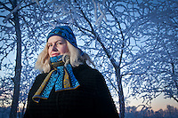Dog walker, Carol Kvale, with frosted trees at Westchester Lagoon, Anchorage