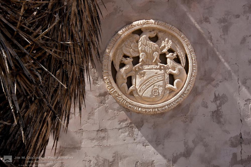 Scotty's Castle wall emblem - Death Valley National Park, California