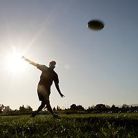 "Members of the Ultimate Frisbee team demonstrate their leaping ability at the University of California, Santa Barbara. The players often perform acrobatic leaps to snare the disc. The team is called the ""Black Tide"" and are known for being one of the best ultimate frisbee teams in the nation."