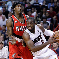 08 March 2011: Miami Heat shooting guard Dwyane Wade (3) drives past Portland Trail Blazers small forward Gerald Wallace (3) during the Portland Trail Blazers 105-96 victory over the Miami Heat at the AmericanAirlines Arena, Miami, Florida, USA.