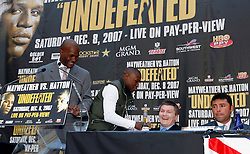 September 19, 2007; New York, NY, USA; World Welterweight Champion Floyd Mayweather Jr gives a beer to World Junior Welterweight Champion Ricky Hatton at the press conference announcing their December 8, 2007 fight.  The fight will take place at the MGM Grand Garden Arena in Las Vegas, Nevada.
