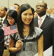 Seetala Woods holds a U.S. flag after becoming a United States citizen during a naturalization ceremony in federal court in Oxford, Miss. on Friday, June 29, 2012. Forty seven persons took the oath of citizenship. (AP Photo/Oxford Eagle, Bruce Newman)