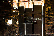 Graffiti marks the inside of an abandoned home in the village of Lukweti, Masisi in conflict-ridden North Kivu, Democratic Republic of Congo, July 29, 2014.  When APCLS rebels clashed with the Congolese army this past February, many villagers fled, leaving behind everything. Many homes were looted and vandalized.