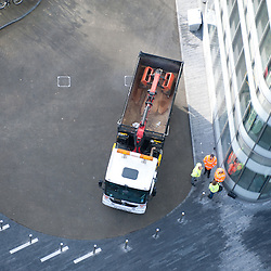 London, UK - 9 december 2013: a new construction lorry with vastly improved driver visibility and safety equipment nearby City Hall.