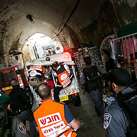Israeli anti riot police officers and paramedics rush after an off road ambulance vehicule evacuating a wounded Palestinian woman that stabbed an Israeli man, who then shot and wounded her in Jerusalem's Old City on Wednesday, Oct. 7, 2015.<br /> Photo by Olivier Fitoussi.