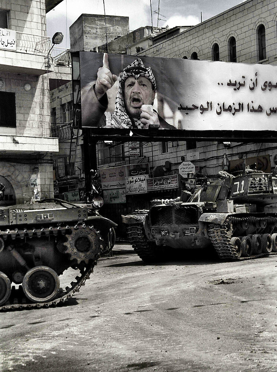 Israeli tanks take position at the center of town in Ramallah, Palestine. March 2002.