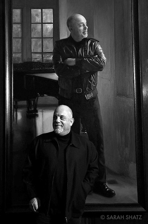 Billy Joel in front of his Steinway Hall portrait at Steinway & Sons