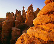 0103-1014 ~ Copyright:  George H. H. Huey ~ Standing rocks [rhyolite formation] at sunset.  Heart-of-Rocks area.  Chiricahua National Monument, Arizona.