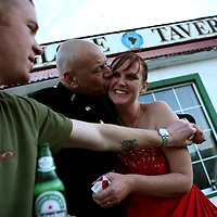 Sgt. Chris Giles, 42, of the British armed forces, kisses his new wife Trina Bernsten, 37, after their wedding reception that was held at the Globe Tavern, a popular bar in Stanley, the capital of the Falkland Islands, on Saturday, March 17, 2007. This year is the 25 anniversary of the war for sovereignty of the islands between the United Kingdom and Argentina. The two-month war resulted in the withdrawal of Argentinean forces and the islands remained part of the United Kingdom. (Photo/Scott Dalton)