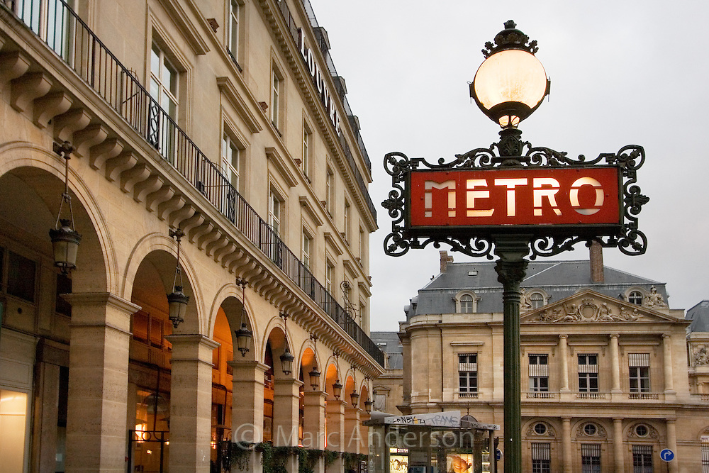 Ornate sign for the Metro subway system, Paris, France.