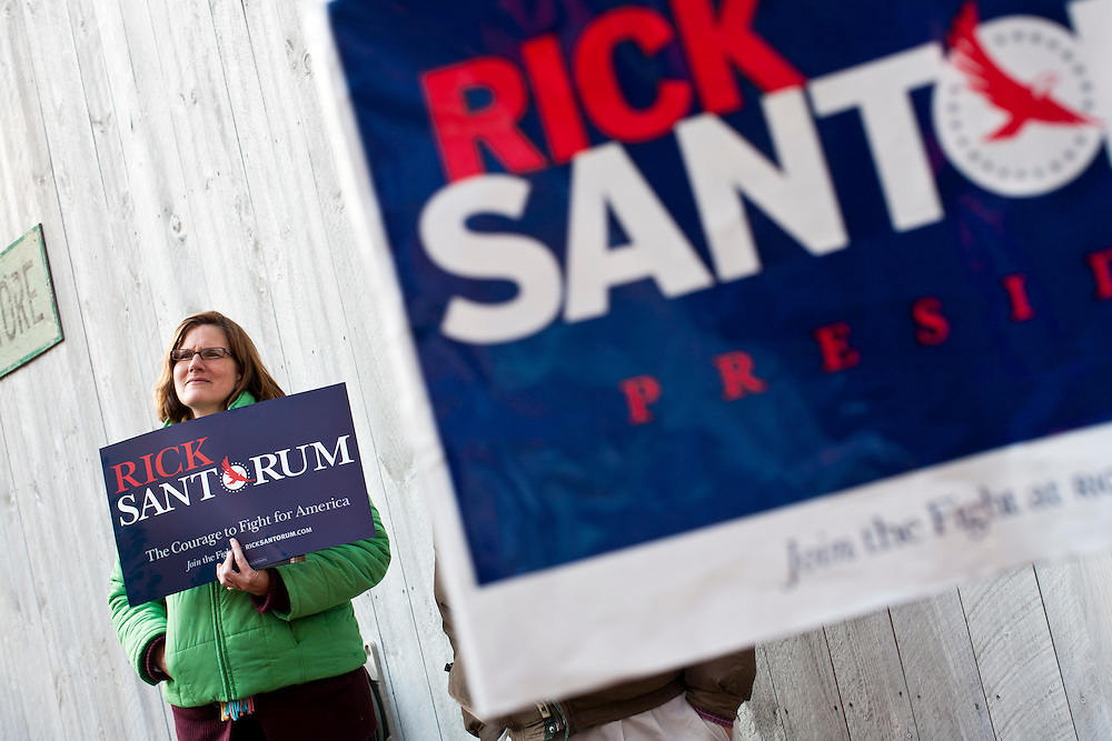 People listen as Republican presidential candidate Rick Santorum hosts a meet and greet at Homestead Grocery and Deli on Saturday, January 7, 2012 in Amherst, NH. Brendan Hoffman for the New York Times