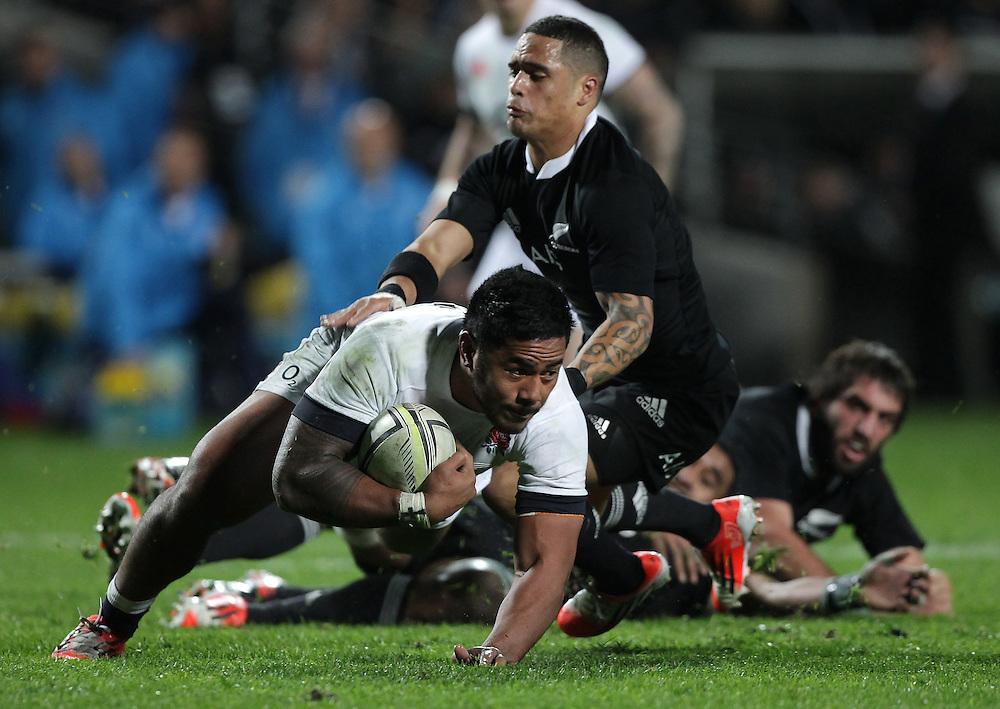 New Zealand's Aaron Smith tackles England's Manu Tuilagi in an International Rugby Test match, Waikato Stadium, Hamilton, New Zealand, Saturday, June 21, 2014.  Credit:SNPA / David Rowland