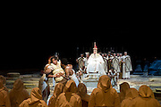 A brand new production of Giuseppe Verdi's awe-inspiring masterpiece, Aida, directed by Stephen Medcalf. The drama unfolds in the very heart of the Royal Albert Hall, drawing the audience in from all sides. With a combined cast of over 120 soloists, chorus, actors and dancers, and with Aida played by Indra Thomas, and Radames by Marc Heller. Photo credit : Tony Nandi