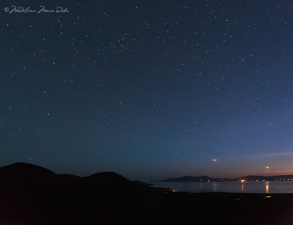 Night sky with millions of stars over Loher, Waterville County Kerry, Ireland<br /> <br /> You can also see the lighthouse of Skellig Michael in the distance.