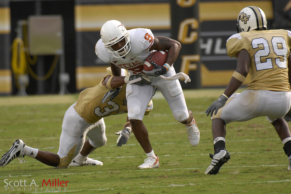 Sep 15, 2007; Orlando, FL, USA; Texas Longhorns receiver (9) Nate Jones eludes Central Florida  Knights defenders (31) Johnell Neal and (29) Sha'reff Rashad during the second quarter at Bright House Stadium. ...©2007 Scott A. Miller