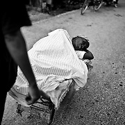The number of cholera victims in CitÈ Soleil, a slum of Port-au-Prince, is increasing day by day exponentially, according to a doctor of Doctors Without Borders.///A woman carries a victim of cholera in a wheelbarrow to the nearest hospital  in the slum of Cite Soleil in Port-au-Prince.