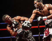 Anthony Woods dodges a punch from Bryan Goldsby  in the super welterweight class Saturday night. Goldsby won the match.