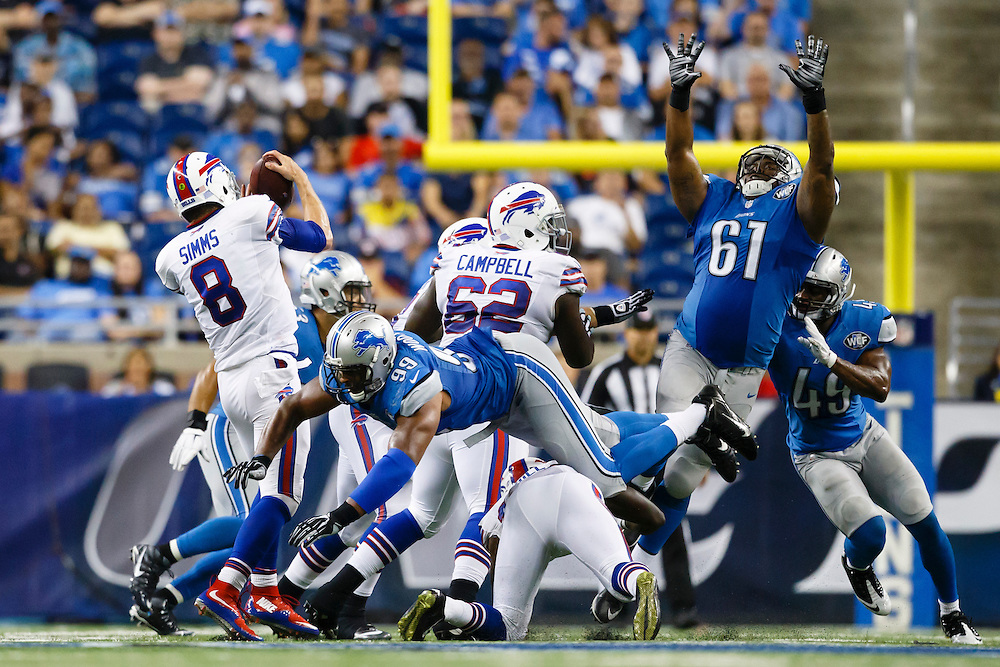 Buffalo Bills quarterback Matt Simms (8) is pressured by Detroit Lions defensive end Corey Wootton (99) and defensive end Kerry Hyder (61) during an preseason NFL football game at Ford Field in Detroit, Thursday, Sept. 3, 2015. (AP Photo/Rick Osentoski)