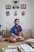 CHINA / Shanghai <br /> <br /> Cai Xiaojun, a 13-year-old student in Shanghai.  He is the leader in arts and recreation of the Young Pioneer in the Minhang Experimental School Affiliate to Shanghai Foreign Studies University<br /> <br /> &copy; Daniele Mattioli for the Financial Times