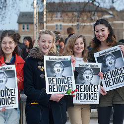 London, UK - 8 April 2013: four women hold banners reading 'Rejoice! Rejoice' in Brixton during the street party for the death of Margaret Thatcher