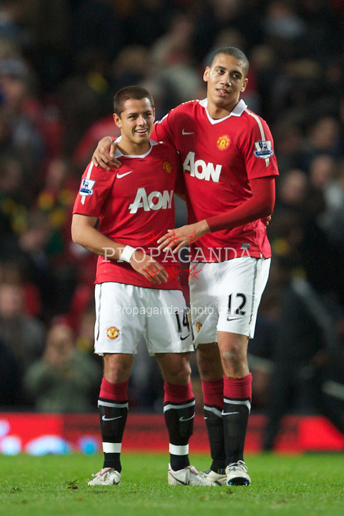 MANCHESTER, ENGLAND - Tuesday, October 26, 2010: Manchester United's match-winner Javier Hernandez with team-mate Chris Smalling after the 3-2 victory over Wolverhampton Wanderers during the Football League Cup 4th Round match at Old Trafford. (Pic by: David Rawcliffe/Propaganda)