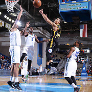 Delaware 87ers Guard Jared Cunningham (17) (CENTER) drives towards the basket as Reno Bighorns Forward Jordan Hamilton (9) defends in the first half of a NBA D-league regular season basketball game between the Delaware 87ers and the Reno Bighorns (Sacramento Kings), Tuesday, Feb. 10, 2015 at The Bob Carpenter Sports Convocation Center in Newark, DEL