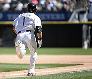 CHICAGO - JULY 23:  Adam Eaton of the Chicago White Sox bats runs toward first base against the Kansas City Royals on July 23, 2014 at U.S. Cellular Field in Chicago, Illinois.   (Photo by Ron Vesely)