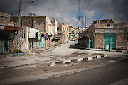 A street of Hebron that used to be a bustling area of shops and markets is now a ghost town. It now consists of sealed-up shops and army checkpoints preventing Palestinians from entering. The entire Old City is now under threat with the same fate. Image © Angelos Giotopoulos/Falcon Photo Agency