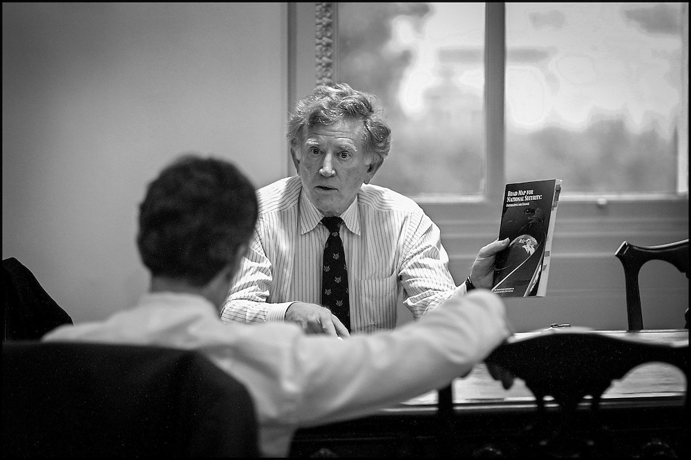 "Former Sen. Gary Hart briefs Sen. Dashle and other Senators during a meeting on terrorism.  He's holding the book ""Road Map to National Security"" 9/24/01..©PF BENTLEY/PFPIX.com"
