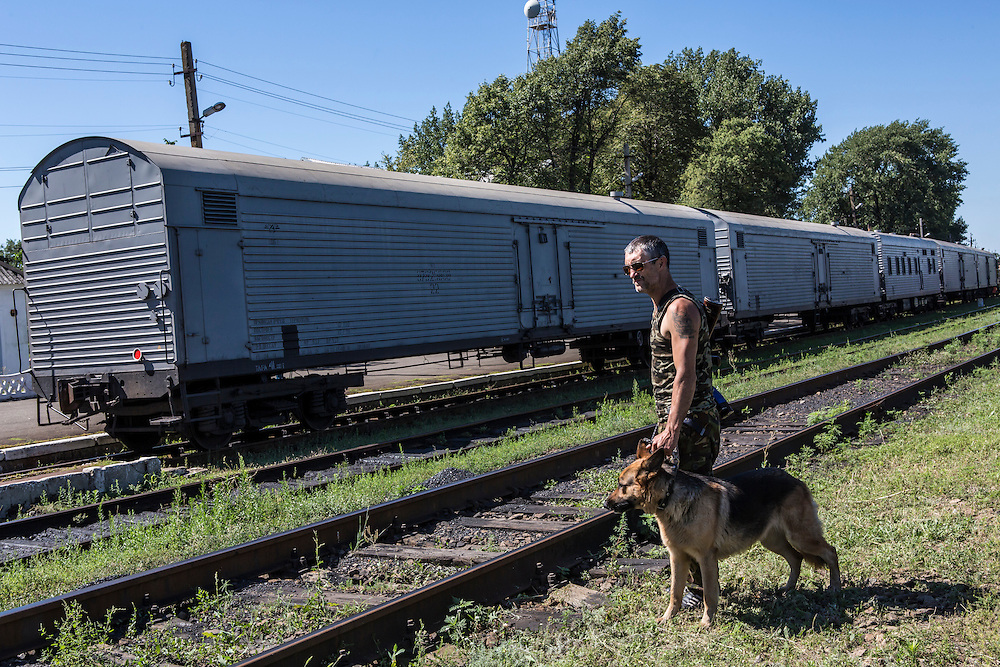 TOREZ, UKRAINE - JULY 21: A pro-Russia rebel guards a train containing the bodies of victims of the Malaysia Airlines flight MH 17 crash on July 21, 2014 in Torez, Ukraine. Malaysia Airlines flight MH17 was travelling from Amsterdam to Kuala Lumpur when it crashed killing all 298 on board including 80 children. The aircraft was allegedly shot down by a missile and investigations continue over the perpetrators of the attack. (Photo by Brendan Hoffman/Getty Images) *** Local Caption ***