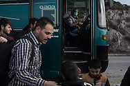 As a bus unloaded just landed refugees in Mithimna transit camp , the driver washes his hands in fear of catching diseases eventually carried by refugees. Refugees from Afghanistan and Syria arrive in boats on the shores of Lesbos near Molivos, Greece on 07<br /> November, 2015. Lesbos, the Greek vacation island in the Aegean Sea between Turkey and Greece, faces massive refugee flows from the Middle East countries.