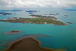 Aerial view of islands and reefs in the Buccaneer Archipelago in the Kimberley wet season.
