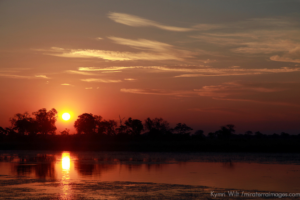 Africa, Botswana, Okavango Delta. Sunset view from the Fish Eagle Bar at Eagle Island Camp, an Orient Express safari property.