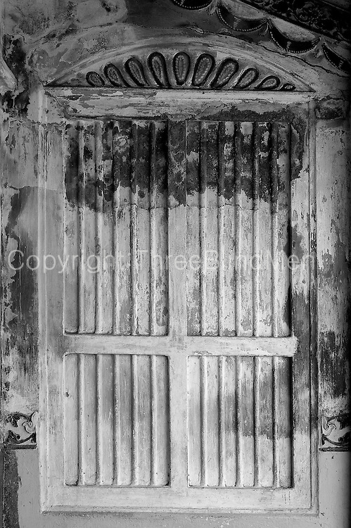 False window at end of a front veranada. Home in Nagore. South India.