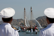 """15th February 2010. Muscat. Oman..Pictures of the Oman naval officers watching """"The Jewel of Muscat"""" leaving the port  and Oman today. Recreating the origanol historic journey to Singapore."""