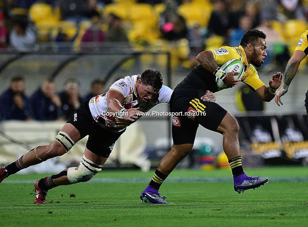 Willis Halaholo (R of the Hurricanes is tackled by Stefan Willemse of the Southern Kings during the Hurricanes vs Kings Super Rugby  match at the Westpac Stadium in Wellington on Friday the 25th of March 2016. Copyright Photo by Marty Melville / www.Photosport.nz