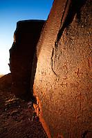 An Ancestral Puebloan (Anasazi) petroglyph panel is bathed in the warm light of the setting sun. Comb Ridge, southern Utah near Bluff.