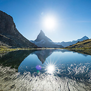 In Zermatt, Switzerland, the Gornergrat rack railway (GGB) takes you to a spectacular ridge (at 3135 m or 10,285 ft) between Gornergletscher and Findelgletscher, with views of 20+ four-thousand meter peaks, whose highest are Dufourspitze (Monte Rosa massif), Liskamm, Matterhorn, Dom and Weisshorn. Gornergrat train, opened in 1898, climbs almost 1500 m or 4900 ft via Riffelalp and Riffelberg in the Pennine Alps, Europe. This image was stitched from multiple overlapping photos.