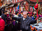 12 MARCH 2017 - KATHMANDU, NEPAL: People participate in a Buddhist wedding procession at Boudhanath Stupa. The wedding coincided with the full moon activities at the stupa. On full moon nights thousands of Nepali and Tibetan Buddhists come to the stupa and participate in processions around the stupa.      PHOTO BY JACK KURTZ