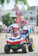 Anna Beth Kilgore (left) and Reed Kilgore ride in the 4th of July parade in Oxford, Miss. on Thursday, July 4, 2013. (AP Photo/Oxford Eagle, Bruce Newman)