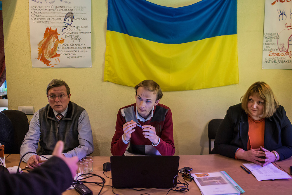 Maksym Osavoliuk, who works with the International Organization for Migration (center), listens to a proposal for a small business loan by an man forced to flee fighting in eastern Ukraine on Monday, April 27, 2015 in Kharkiv, Ukraine. IOM will offer loans of up to 650 euros for qualifying small business ideas for IDPs. CREDIT: Brendan Hoffman/Prime for the Wall Street Journal UKRMIGRATION