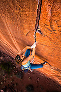 "Pro climber Steph Davis climbing ""Hidden Gem"" rated 5.13, near Moab Utah."