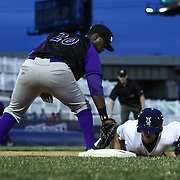 Winston-Salem Dash Infielders Keon Barnum (20), LEFT, attempts to tag Wilmington Blue Rocks Outfielder Daniel Rockett (14), RIGHT, at first base during a MLB minor league regular season baseball game between the Wilmington Blue Rocks and the Winston-Salem Dash Monday, April 14. 2014 at Daniel S. Frawley Stadium in Wilmington, DEL.