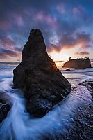 Sunsest light illuminates sea stacks and clouds along Ruby Beach, Olympic National Park, Washington
