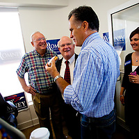 TAMPA, FL -- September 2, 2011 -- Republican presidential candidate, former Massachusetts Gov. Mitt Romney, eats a donut as he greets staff and supporters at his new campaign headquarters in downtown Tampa, Fla., on Friday ,September 2, 2011 .